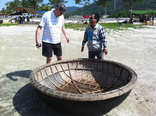 """Mui Ne, Vietnam: Quang explaining how the """"basket fishing boats"""" are made and used"""