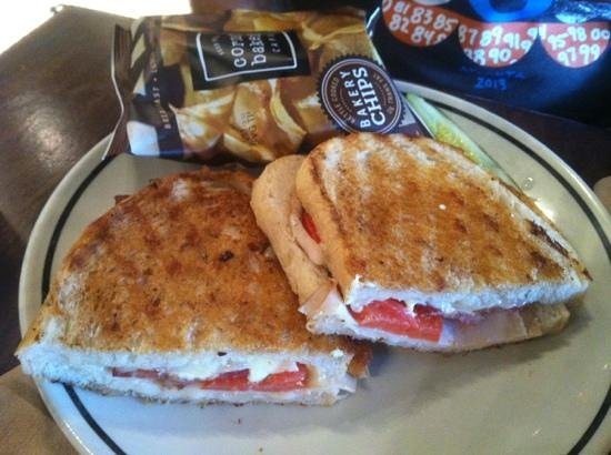 club panini with cheese, tomato, mayo and turkey (I think). Chips and ...