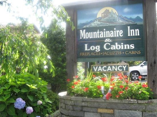 Sign Picture Of Mountainaire Inn And Log Cabins Blowing