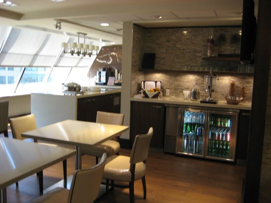 Sheraton Ottawa Hotel: Club lounge -beverage fridge with view of coffee station in back left.