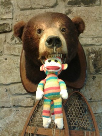 Bolton Valley, VT: Sock Monkey being drooled on by one of the bears in the inn