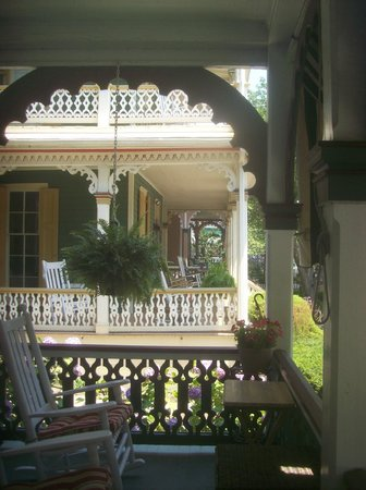 Pharo's Inn: Porch view sit & rock away a summer day of horse/buggy driving by or cozy nite with a glass of w