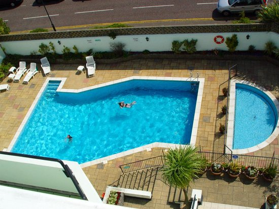 Indoor Pool With View Of The Outdoor Pool Picture Of Menzies Carlton Hotel Bournemouth