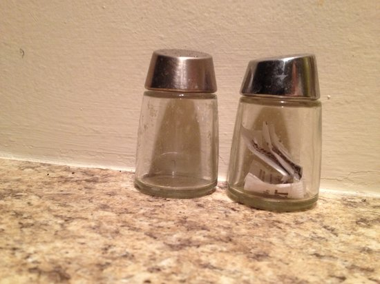 Quality Suites: The ever so classy salt and pepper shakers with pepper packets in them