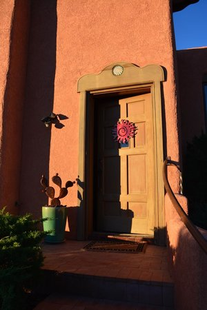Casa Cuma Bed & Breakfast: The welcoming door at Sunset House in the morning light.