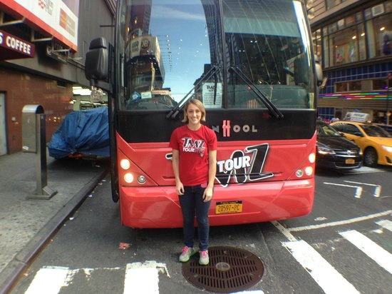 Tour guide sarah posing with the bus picture of tmz tour for Tmz tour new york city