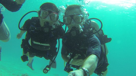 Coki Dive Center: My wife and I at Coki Beach. They were awesome!