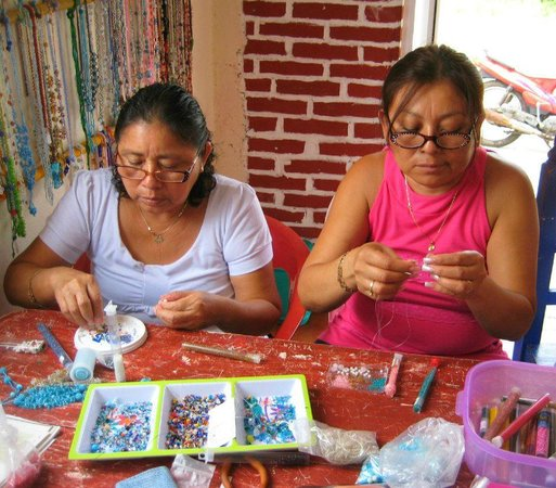 Women beading in the coop