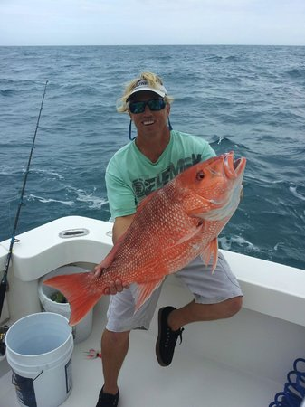 Captain brad with red snapper offshore daytona beach for Deep sea fishing daytona beach fl