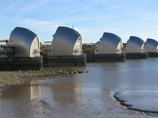 View of the Thames Barrier at low tide from the end of the