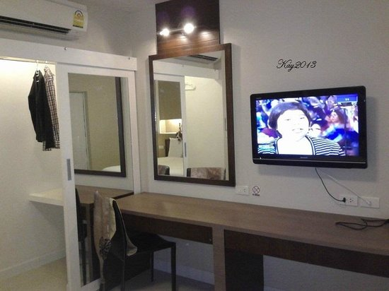 Ample storage space and big flat screen tv picture of for Ample storage space