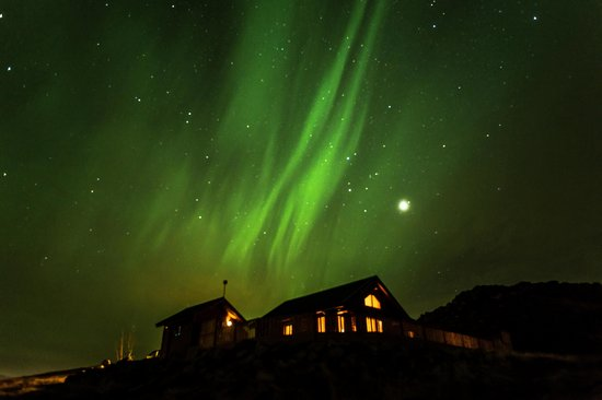 northern lights over cedar log cabin picture of selfoss