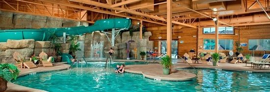 Indoor outdoor pool with slide and kid 39 s zone picture of for Branson mo cabins with indoor pool