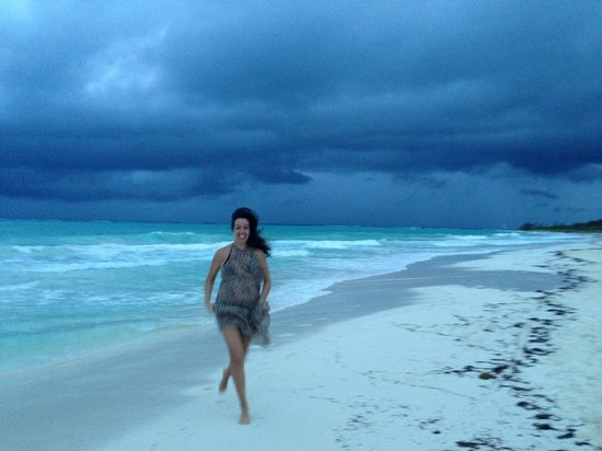 Secrets Maroma Beach Riviera Cancun: Running from the storm!  Embrace the pop up showers so much fun!