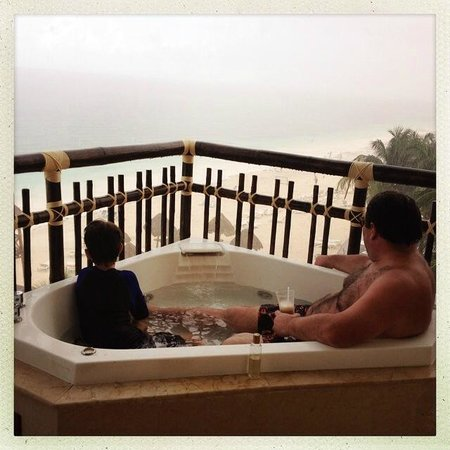 Hangout out in our hot tub on the balcony during a rain for Balcony hot tub