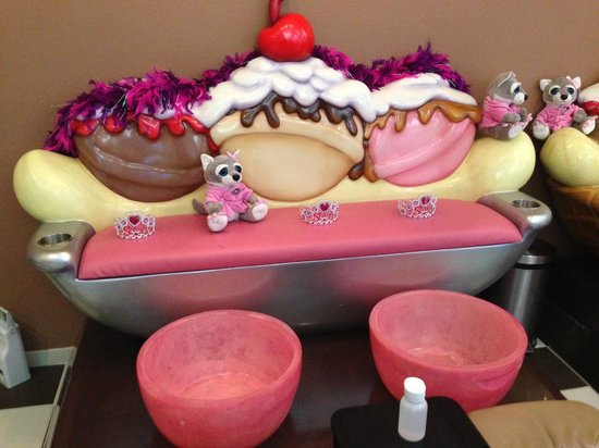 """What could be more fun than an ice-cream themed spa for kids? It's a delicious dream come true at Scooops Kid Spa. Sit on top of a banana-split throne while wearing a sparkling tiara and choose a favorite """"flavor"""" for all kinds of sweet-themed treats including manicures/pedicures, sherbet Location: N US 31 South, Traverse City, , MI."""