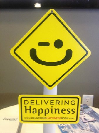 delivering happiness logo - picture of zappos tour experience
