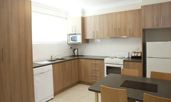 Deluxe family apartment kitchen laundry dning view for Kitchen xchange narellan