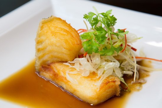 Pan fried cod fish served with pomelo in superior soya for Cod fish in chinese