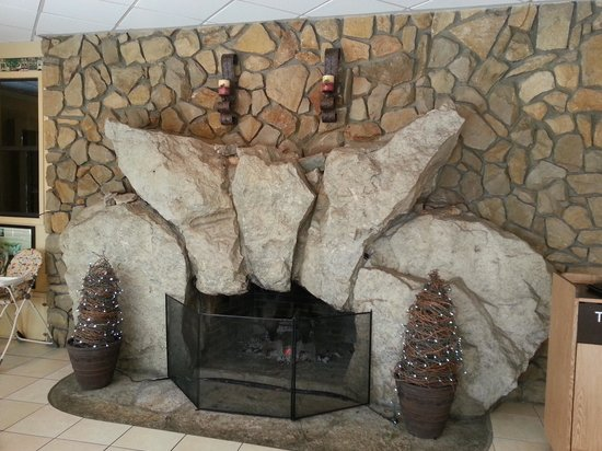 Terrace Inn and Suites: 1 of 2 cool fireplaces in the lobby area 550 x 412
