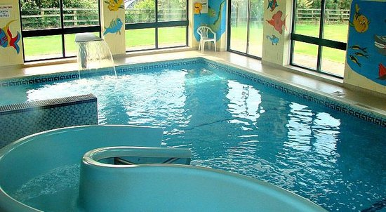 Heated indoor swimming pool with water slide picture of - Swimming pools with slides in yorkshire ...