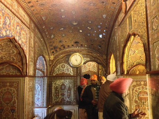 inside of the temple with rubies and gold encrusted walls