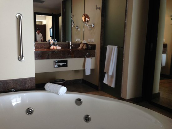 large bathroom with jacuzzi tub walk in shower separate