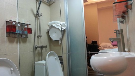 cover the toilet seat and shower over it picture of homy inn hong kong tripadvisor. Black Bedroom Furniture Sets. Home Design Ideas