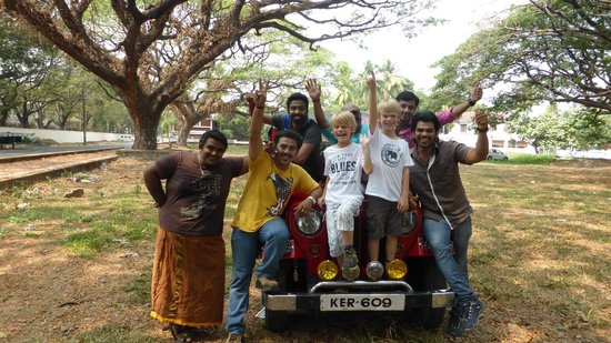A photo with a group of youngsters in Kerala near a Jeep.