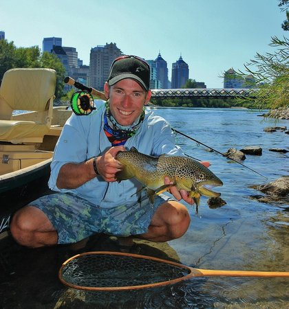 Guide josh nugent spotting subtle rise forms from trout at for Chicago fly fishing outfitters