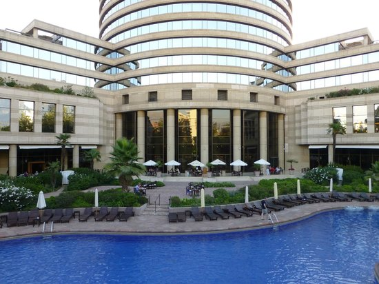 Grand Hyatt Santiago: back of the hotel with garden and pool