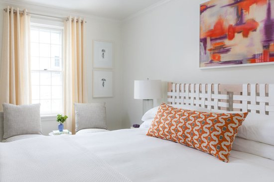 Luxurious white linens and pops of color define this for Designhotel definition