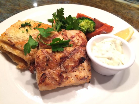 Sea bass with signature scalloped potatoes picture of for Flying fish bar and grill
