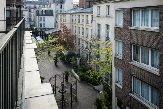 View from the shallow balcony of the room looking over for Hotel les jardins paris