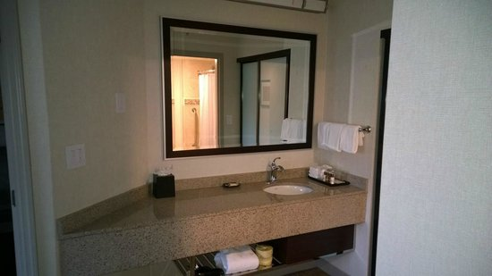 sheraton suites orlando airport sink in bedroom with view to bathroom