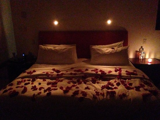 candles and rose petals in the bedroom bedroom rose petals and