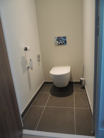 Commode toilet located separately from shower sink for Hotel paris porte maillot
