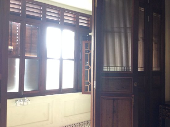 Seven Terraces: The beautiful wooden-paneled doors which open to the expansive washroom with rain shower.