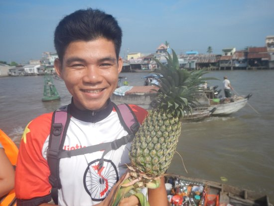 Vietnam Backroads - Bicycle Tours: Our fabulous guide Dat at the floating market.  He really made our trip :)