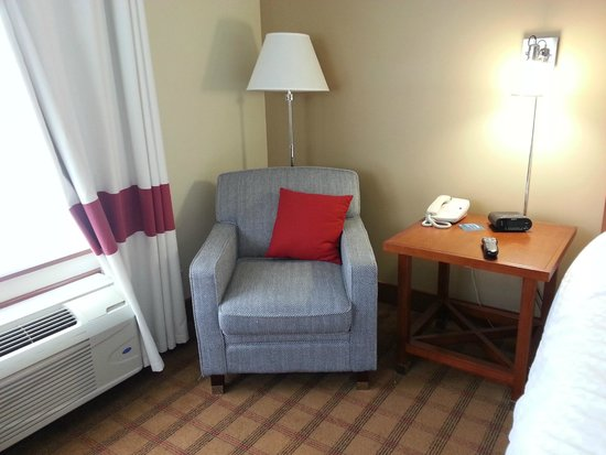 Four Points by Sheraton Victoria Gateway: One chair in Open Concept Suite and non stop fan