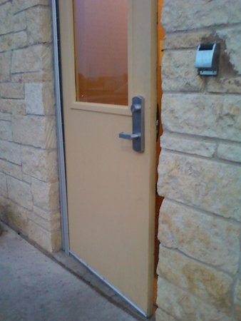 Holiday Inn Express Hotel & Suites Amarillo South: Door stuck open during our entire stay...