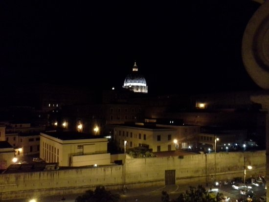 A View of Rome : view of Vatican at night from the room.