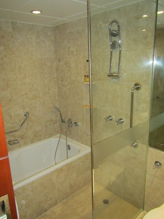 view of glass enclosed shower and bathtub shower was nice picture of sheraton hong kong hotel. Black Bedroom Furniture Sets. Home Design Ideas