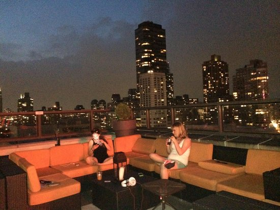 Empire Hotel: My daughters chilling on the incredible rooftop terrace.