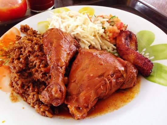 Stew chicken with dirty rice, cole slaw, fried plantains and pico de ...