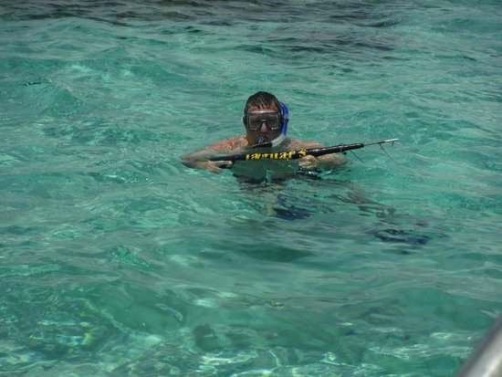 Lobster spear fishing tour feast beach bbq picture of for Fishing san pedro belize
