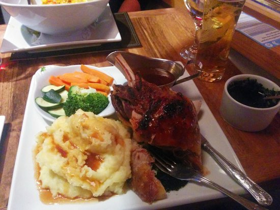 Lamb shank with mash veggies and mint sauce picture of for The pheasant pub london