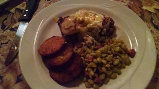 Mr. P's Bistro: Beef tenderloin, covered with seared scallops and crabmeat. Fried green tomatoes limas and andou