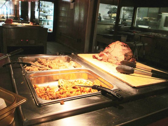 Hand carved roast beef is at this carving station on the