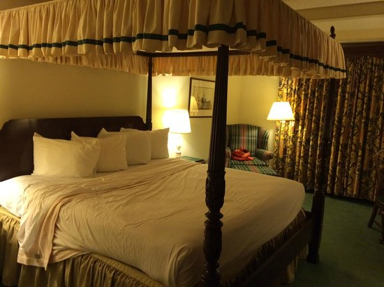 The Desmond Hotel: Four poster bed, plaid chair - Room 210